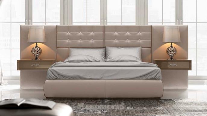 Dormitorio contemporaneo tapizado de Muebles Toscana
